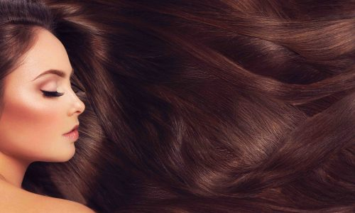 Profile of beautiful woman with long silky brown hair